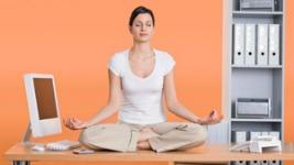 20100514-woman-meditating-work-300x205